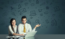 Business couple with media icons background Stock Photography