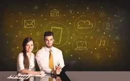 Business couple with media icons background Royalty Free Stock Image