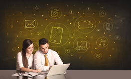 Business couple with media icons background Stock Photos