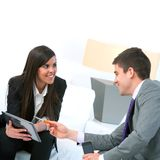 Business couple at meeting with tablet. Stock Images