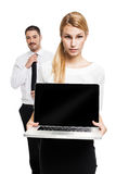 Business Couple with a Modern Laptop Royalty Free Stock Photos