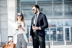 Business couple near the airport Royalty Free Stock Image