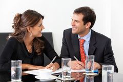 Business couple at the office Royalty Free Stock Images