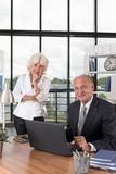 Business couple in office Royalty Free Stock Images