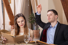 Business couple ordering dinner Stock Images