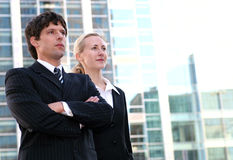 Business couple outdoors. Businesswoman and man standing outdoors Stock Photos