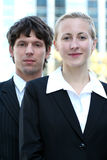 Business couple outdoors. Businesswoman and man standing outdoors Stock Images