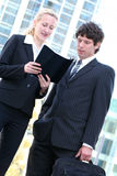 Business couple outdoors. Businesswoman and man standing outdoors Royalty Free Stock Photo