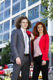 Business couple. Outside, standing together Stock Image