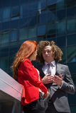 Business couple. Outside, standing together Stock Images