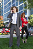 Business couple. Outside using phone Royalty Free Stock Photography