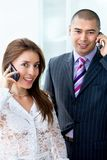 Business couple on the phone Royalty Free Stock Images