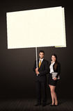 Business couple with post-it paper Royalty Free Stock Photography