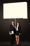 Business couple with post-it paper Stock Images