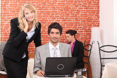Business couple in a restaurant Royalty Free Stock Photo
