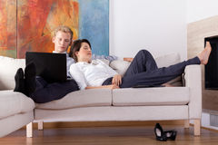 Business couple resting at home. Tired business couple resting at home, horizontal Royalty Free Stock Photo
