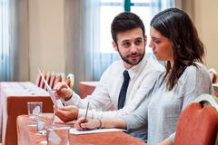 Business couple reviewing work in conference room. Stock Image