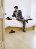 Business Couple Romancing In Bed Stock Photo