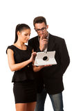 Business couple searching ideas on tablet computer. Team work co Stock Photography