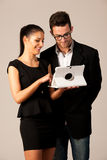 Business couple searching ideas on tablet computer. Team work co Stock Photo