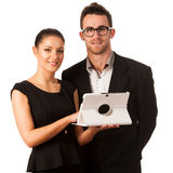 Business couple searching ideas on tablet computer. Team work co Stock Images