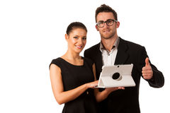 Business couple searching ideas on tablet computer. Team work co Stock Photos