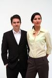 Business Couple - serious. Image of two business people, mature, 30 somethings, serious professional look stock image