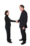 Business couple shaking hands Royalty Free Stock Images