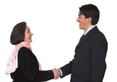Business couple shaking hands Stock Photography