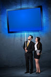 Business couple with shining tablet Royalty Free Stock Photos