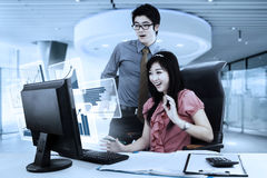 Business couple with shocked expression royalty free stock photos