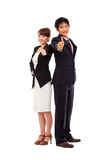 Business couple showing thumb. Royalty Free Stock Image
