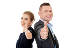 Business couple showing thumbs up Stock Image