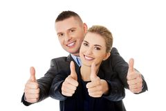 Business couple showing thumbs up.  Royalty Free Stock Image