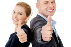 Business couple showing thumbs up.  Royalty Free Stock Images