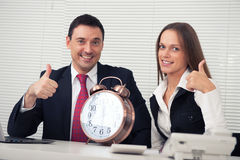 Business couple showing thumbs up Stock Photography
