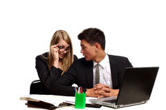 Business couple sitting at table Royalty Free Stock Images