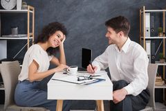 Business couple sitting and talking at modern office stock photos
