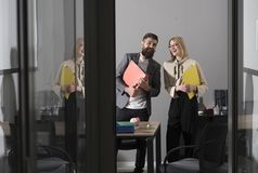Business couple smile meeting in office. Happy colleagues in modern office. Bearded man and sensual woman smiling with. Business couple smile meeting in office stock photo