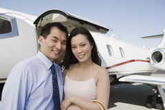 Business Couple Smiling Together At Airfield Stock Photography