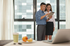 Business couple smiling and working together in hotel room Royalty Free Stock Image