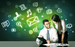 Business couple with social media symbols Royalty Free Stock Images
