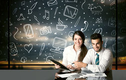 Business couple with social media symbols Stock Photo