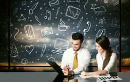 Business couple with social media symbols Royalty Free Stock Photo