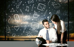 Business couple with social media symbols Stock Photography