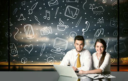 Business couple with social media symbols Royalty Free Stock Photography