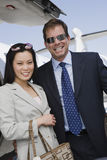 Business Couple Standing At Airfield Stock Image