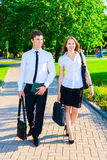 Business couple strolling. Business couple walking down the street and talking Royalty Free Stock Images