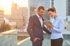 Business couple with tablet. Stock Photos
