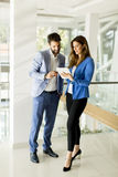 Business couple with tablet Royalty Free Stock Images